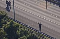 Amsterdam highway arrest: Police 'hold man at gunpoint after bus bomb claim on busy motorway'