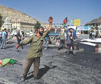 Twin blasts kill 80 at Kabul Shia rally