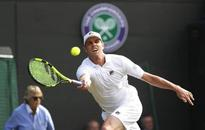 Querrey survives scary moments to down Djokovic
