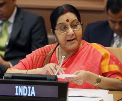 India ready to work above and beyond Paris deal: Swaraj