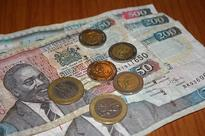 Kenyan shilling firms, helped by charity, investor dollar inflows