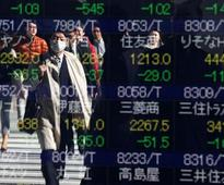 Global Markets - Oil, equities, emerging markets end year of shocks on triumphant note