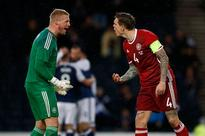 Daniel Agger rows with Kasper Schmeichel after howler gifts Scotland victory over Denmark
