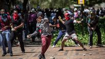 South African police use tear gas, water canon to disperse student protesters in Pretoria