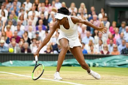 Error-prone Venus heaps praise on Muguruza after Wimbledon heartbreak