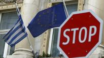 Germany wants Greece in euro zone, IMF says no special deals