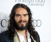 Russell Brand to become a father: Laura Gallacher tamed the former lothario but who is she?