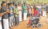 Alumni of Kerala Varma College gifts Shabana a motorized wheel chair