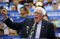 Sanders raises more cash but Clinton makes campaign dollars go further