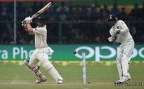 Williamson leads NZ reply on rain-hit day