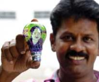 Thanking Amma for free power artist thrones her inside electric bulb!
