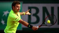 Wawrinka buoyant as title defence continues
