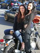 Lana Del Rey and The Strolling Lifeless's Norman Reedus hang around on bikes