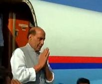 Rajnath arrives in Pak as terror groups protest