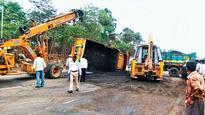 Sand-laden truck turns turtle on Mumbai-Ahmedabad highway