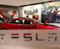 Tesla cuts 'self-driving' from China site