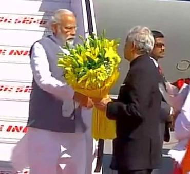 PM Modi arrives in Dehradun for Rawat's swearing-in ceremony