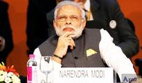Modi in a spin as he replaces…