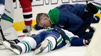 Canucks' Philip Larsen leaves game on stretcher after huge hit by Taylor Hall