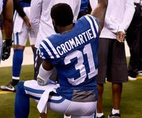 Ex-Colts' wife says he was cut for anthem kneel - report
