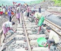 400 toil to repair landslip-hit tracks