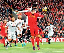 Rampant Liverpool take top spot, Arsenal held by Spurs