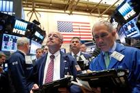 Wall St climbs after Fed stands pat on rates