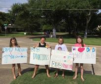 Girls' lemonade stand raises $10K for families of fallen Dallas police officers