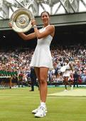 Muguruza stuns Venus Williams to win first Wimbledon title