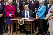 Trump Sits At Child-Sized Desk To Axe Children's Education Standards
