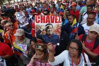 Venezuelans attend tribute to Hugo Chavez, Simon Bolivar in Caracas