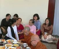 The Lady, Surrounded by the Generals and Their Families