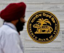 RBI keeps policy rate on hold, keen to drain system's excess cash