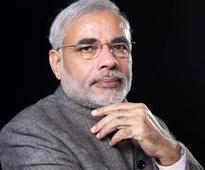 U'khand: Modi calls up Bahuguna, assures assistance