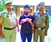 Absconder arrested, 15 gms heroin recovered