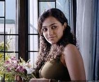 Tamil 22 Female Kottayam: Nithya Menon in Rima Kallingal shoes