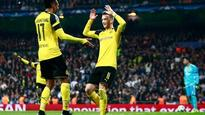 Champions League round-up: Borussia Dortmund draw at Real Madrid to secure top spot, victory for Juventus and more