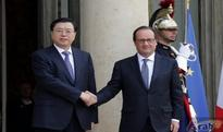 Chinese, French leaders vow to boost ties, cooperation