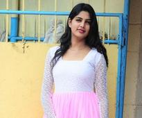 Model Navamy sizzled in a pink flawless gown at a film pooja in Trivandrum