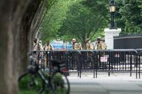 White House on alert after metal object hurled over fence