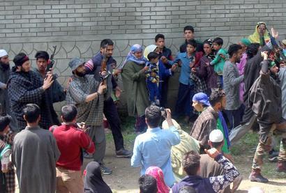 In Kashmir, terrorists give 'gun salute' to slain associate at funeral