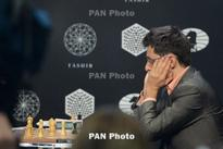 Aronian draws with Chess Candidates leader Karjakin in R13