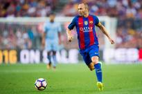 Andres Iniesta says not even Pep Guardiola could change his plans to retire at Barcelona