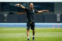 Guardiola to shake on renewed Mourinho rivalr... Manchester City coach Pep Guardiola attends training. (REUTERS/Thomas Peter)...