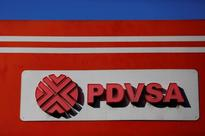 Venezuela's cash-strapped PDVSA offers Rosneft oil stake - sources