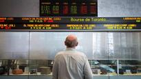 North American markets edge higher in early trading, loonie down