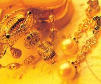 Indian gold futures edge lower  Wednesday near 19 months lowest level