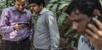 'Govt Wants To Merge Jan Dhan Accounts, Aadhar And Smart Phones'