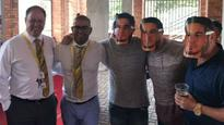 CSA officials pose with fans wearing mask of man who had affair with Warner's wife, apology issued