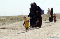 Families gather at Khaled office to flee away from IS militants